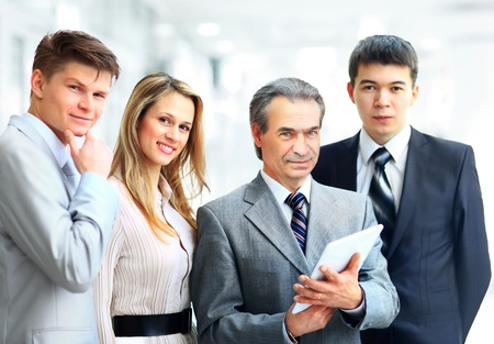 Portrait of businessman leading his team at office photo