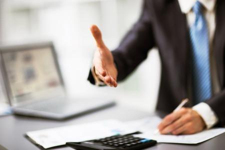 Portrait of a successful businessman giving a hand 免版税图像 - 35842938