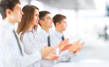 applauding: Happy business group applauding at the office Stock Photo