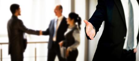 A business man with an open hand ready to seal a deal Standard-Bild