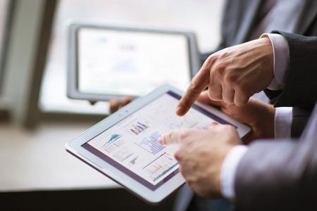Hands of people working with tablet computer. Standard-Bild