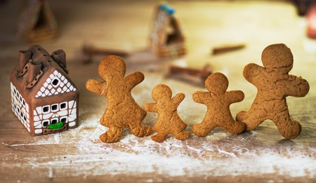 gingerbread men on the wooden floor with Christmas decorations photo