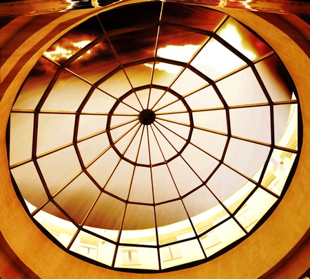round glass roof with an incredibly beautiful sunset photo