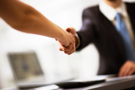 hand job: Business people shaking hands, finishing up a meeting Stock Photo