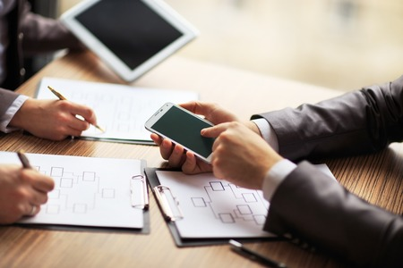 Business team working on a scheme business using the tablet and smartphone