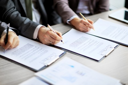 legal contract: Business young people in the job interview, signed an employment contract with boss in the office Stock Photo