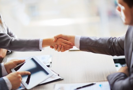 lawyer meeting: Business people shaking hands, finishing up a meeting Stock Photo