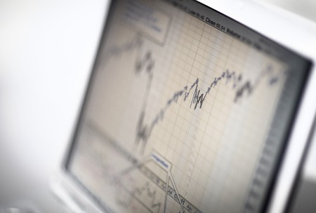 Businessman analyzing investment charts with laptop. Accounting Reklamní fotografie