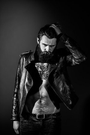 portrait of brutal man on a black background
