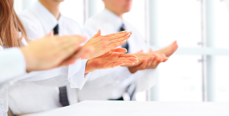Close-up of business people clapping hands. Business seminar concept Stock Photo - 44722846