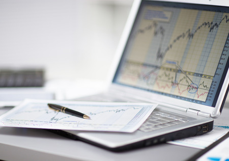 Businessman analyzing investment charts with laptop. Accounting Archivio Fotografico