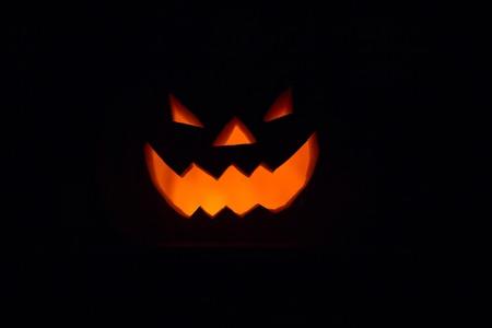 hollows: Halloween - old jack-o-lantern on black background