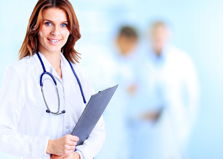 Smiling medical woman doctor at Hospital Stock Photo