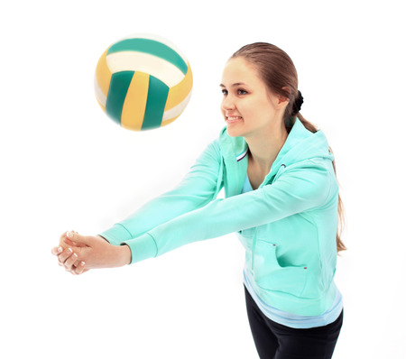 sportingly: The beautiful young woman plays sports on a white background
