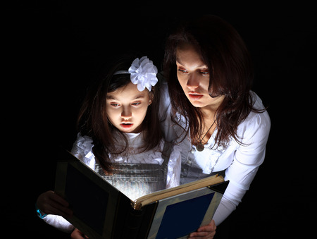 light to dark: Girl with my mother found a wonderful book.