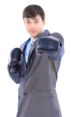supervisory: The young businessman in boxing gloves. Isolated on a white background. Stock Photo
