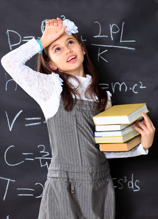 mathematical: The little girl decides to mathematical equations.