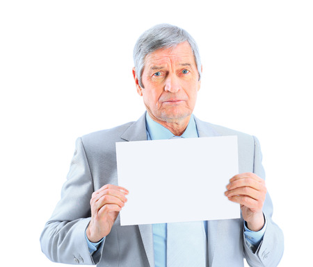 oft: Nice businessman at the age oft holding a big white poster. Isolated on a white background.