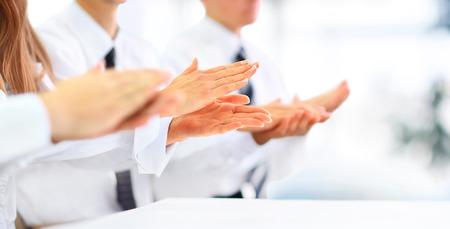 clapping hands: Close-up of business people clapping hands. Business seminar concept