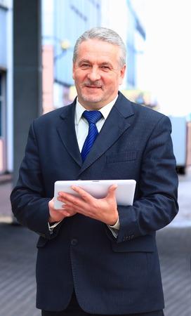 websurfing: handsome businessman using tablet computer in modern office
