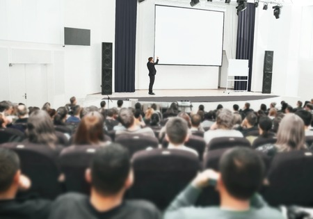 the speaker at a business presentation