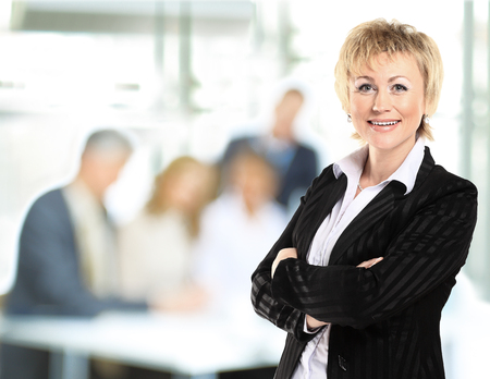 team from behind: confident business woman with team behind her Stock Photo