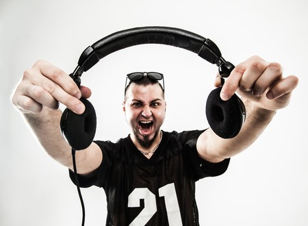 portrait of a charismatic disc jockey with headphones in the for Stock Photo