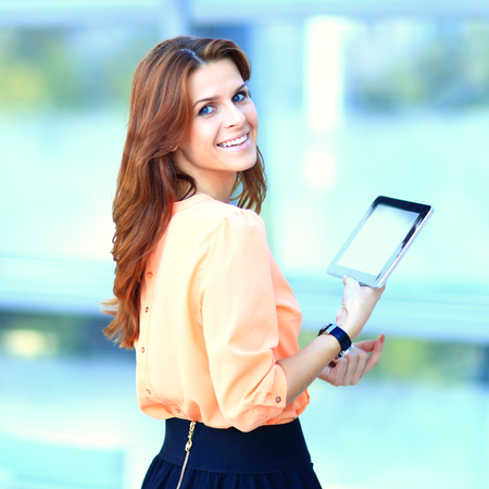 Beautiful girl and successful businessman using her digital tablet