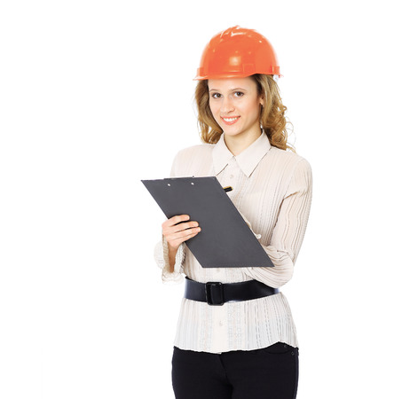 architectural studies: Woman engineer in a helmet with a folder in her hands