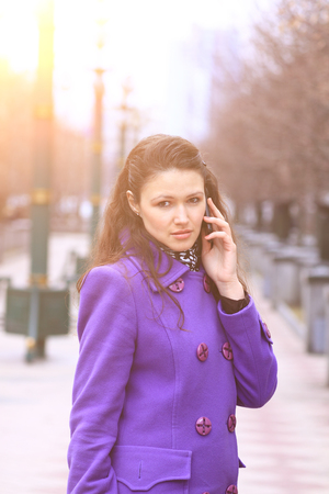 Beautiful girl talking on the phone on the street Stock Photo