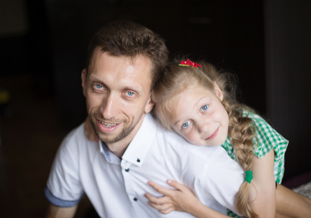 dad with his beloved little daughter on a dark background Stock Photo