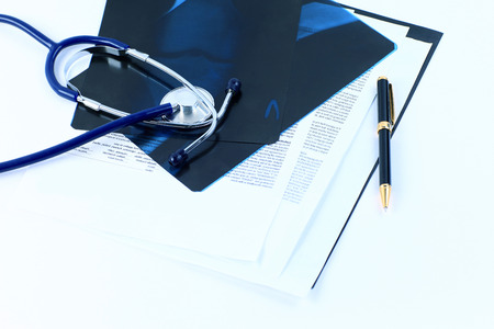 Medical documents of fluorography with pen and stethoscope the table