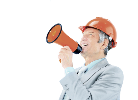 An experienced architect of an age looks up and yells into shout. Stock Photo