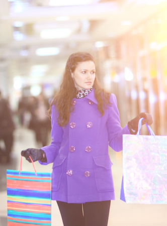 Beautiful girl with shopping goes shopping with bags.