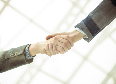 handshake of business partners after signing the contract. Stock Photo