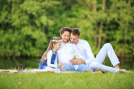 concept of family happiness - pregnant mother and happy father a Stock Photo
