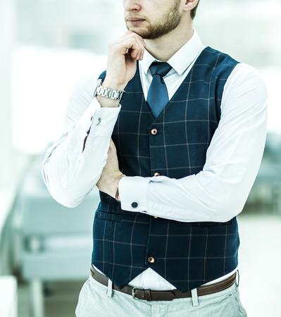 beginner: thoughtful beginner businessman standing near the window