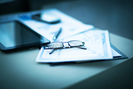 economic forecast: Business financial analysis of the workplace with the glasses on the documents