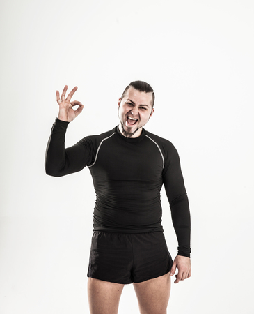 concept of victory in sports-happy bodybuilder rejoice their vic