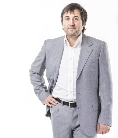 portrait of confident businessman in business suit on white background