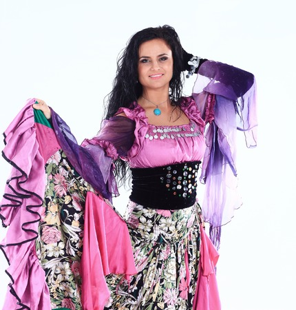 portrait of a beautiful Gypsy dancer performs the dance on a white background 스톡 콘텐츠