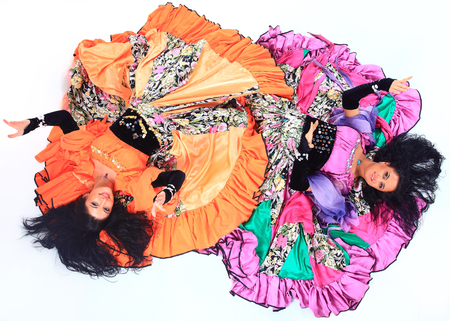 Gypsy dance group in national costumes performing folk dance.
