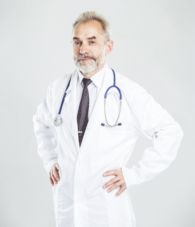 experienced therapist with a stethoscope on light background.