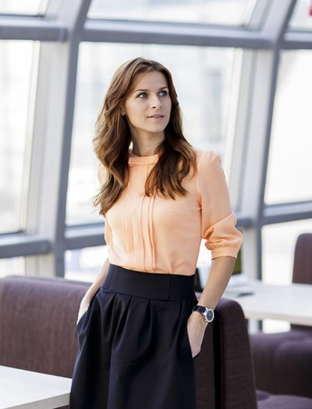 modern business woman standing in lobby of modern office
