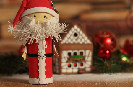 gingerbread house,Christmas balls and Santa Claus. the concept