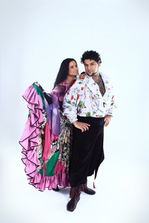 professional dance couple in a Gypsy costume perform folk dance