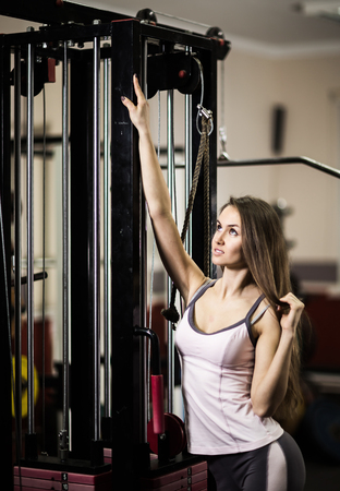 Portrait of confident business woman in the gym