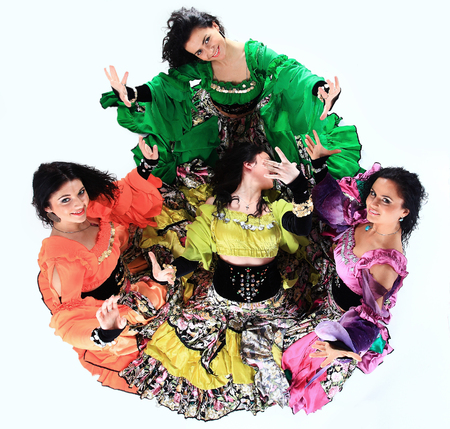 professional Gypsy dancing group in national costumes performing folk dance. 스톡 콘텐츠