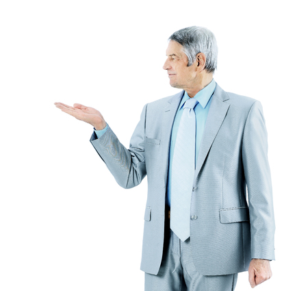 Businessman in age, with an outstretched hand. Isolated in the white background.