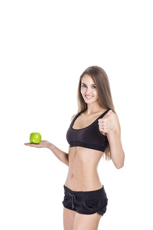 concept of a healthy lifestyle: portrait of a female fitness instructor with an Apple in his hand Foto de archivo